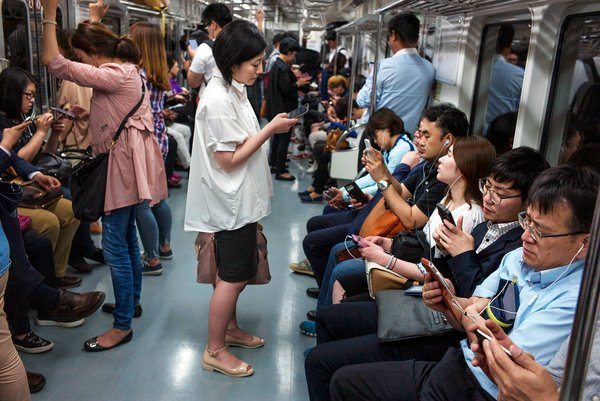 Koreans playing games in subway cars
